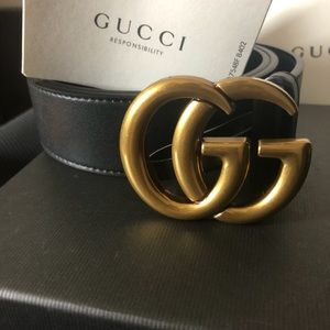 Women's Gucci belt with gold buckle